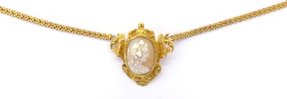 NECKLACE holding a pendant brooch adorned with a cameo in an entourage of volutes....