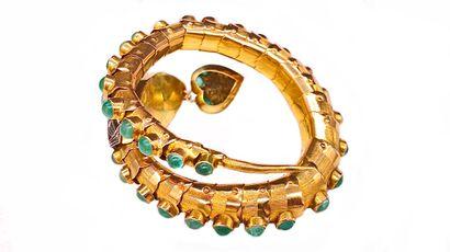 BRACELET en or jaune 14K et argent représentant un serpent articulé orné de cabochons...