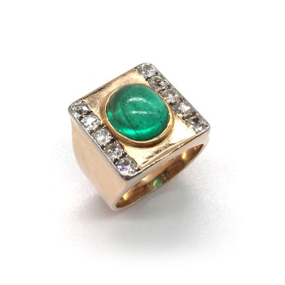 HORSE RING holding a cabochon emerald surrounded by two lines of old cut diamonds....
