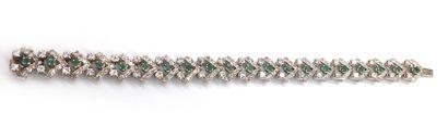 BRACELET featuring alternating geometric patterns adorned with brilliant-cut diamonds...