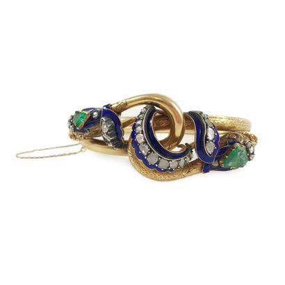 BRACELET ÉPOQUE XIXème présentant deux serpents entrelacés au décor finement ciselé...