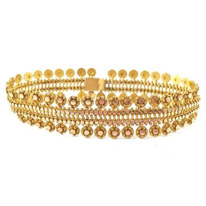 BRACELET souple au décor de dentelle. Monture en or jaune 18K (manques). Longueur...