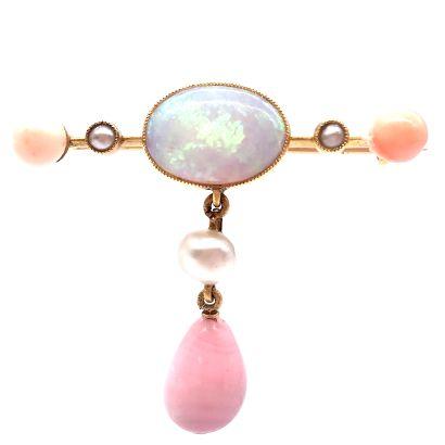 BROCHE ornée d'une opale blanche, entourée...