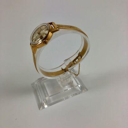 OMEGA Ladymatic Vers 1950. Montre bracelet en plaqué or jaune, boitier rond, cadran...