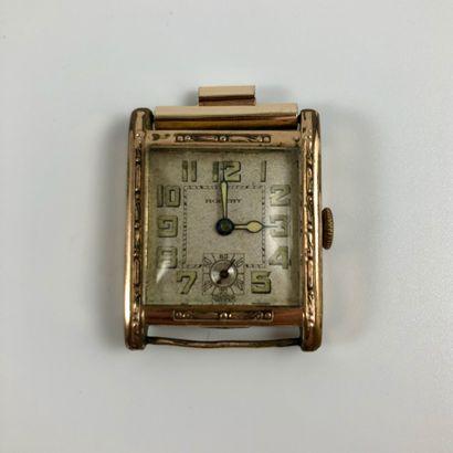 ROBERT. Montre rectangulaire en métal plaqué or, laminé. Index chiffre arabes. Compteur...