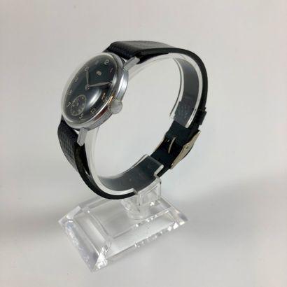 ARSA Vers 1950. Réf: 53XXX.. Montre bracelet en acier, boitier rond, cadran noir...