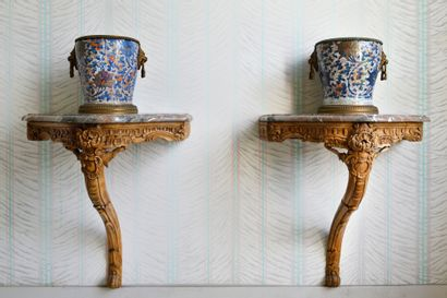 JAPAN A pair of imari earthenware vases decorated with flowers on a celadon background,...