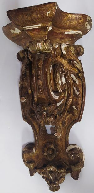 A giltwood, moulded, carved and openwork console with foliage and scrolls. 18th...