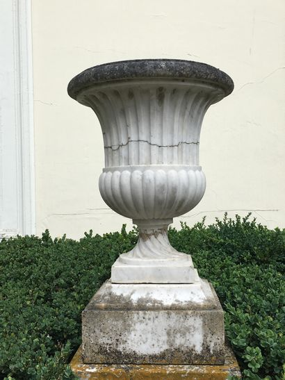 SET OF FOUR MEDICIS VESSELS in white marble with channels and gadroons, round base...