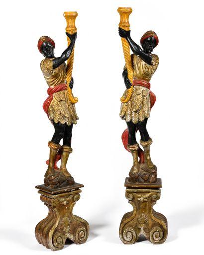 Paire de NUBIENS en bois sculpté et polychromé...