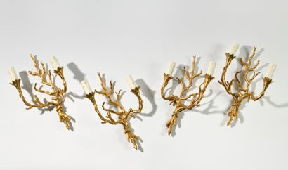 JANSEN Suite de quatre appliques en bronze...