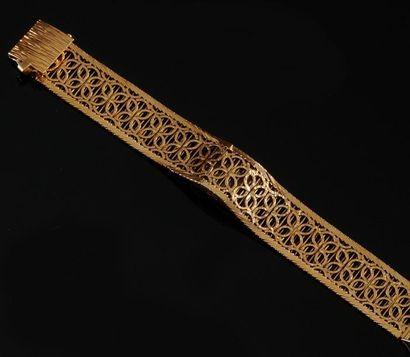 MONTRE en or jaune, le bracelet manchette...