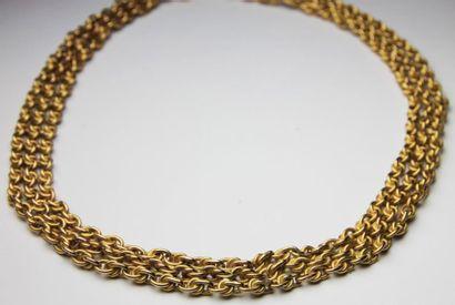 COLLIER en or jaune composé de trois ranges...