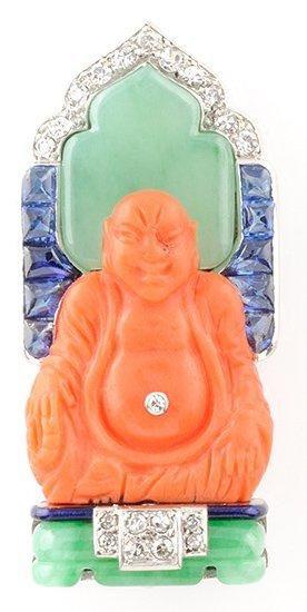 CARTIER BROCHE en or gris et platine stylisant un bouddha assis en corail, dans un...