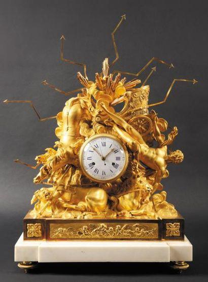 Importante pendule en bronze doré représentant la chute de Phaéton Le cadran emaille...