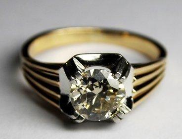 BAGUE SOLITAIRE en or gris ornée d'un diamant...