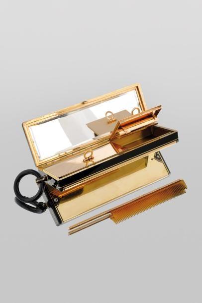 CARTIER Exceptionnel nécessaire du soir, en or jaune, émail, entourage filet émail...