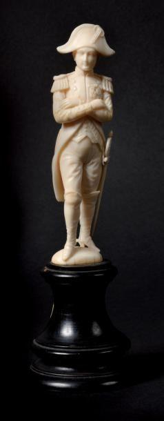 «L'empereur Napoléon Ier en pied les bras croisés». Fine statuette en ivoire montée...