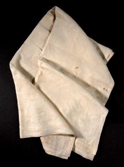 L'empereur Napoléon Ier - Une chaussette tissée en fins fils de coton blanc, ornée...
