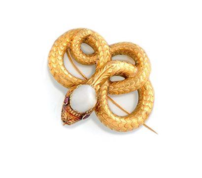 BROCHE en or jaune stylisant un serpent,...