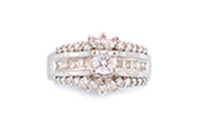 BAGUE en or gris ornée d'un diamant de taille...