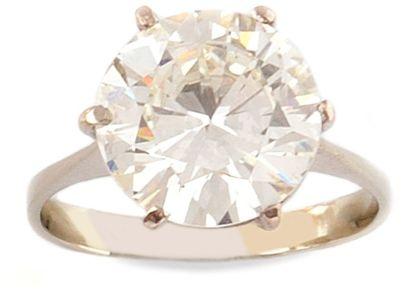 SOLITAIRE en or gris orné d'un diamant de taille brillant pesant 4,48 carats certifié...