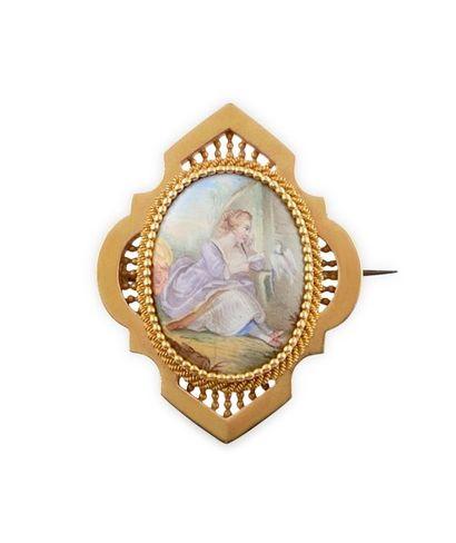 BROCHE en or jaune décoré d'une miniature...