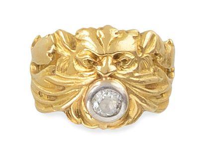 BAGUE or jaune retenant un diamant demi-taille...