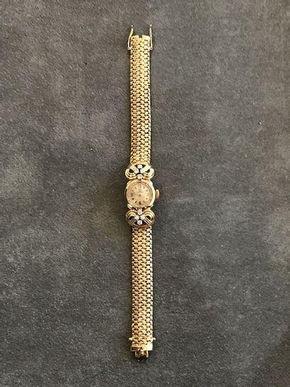 OMEGA  Montre bracelet de femme en or jaune...