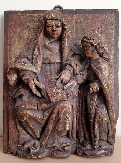 PANNEAU en bois sculpté en fort relief, polychromé...