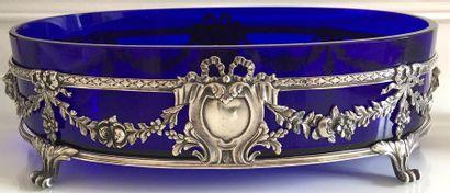 JARDINIERE ovale en verre bleu, la monture...