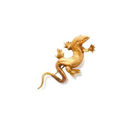BROCHE représentant un reptile en or jaune...