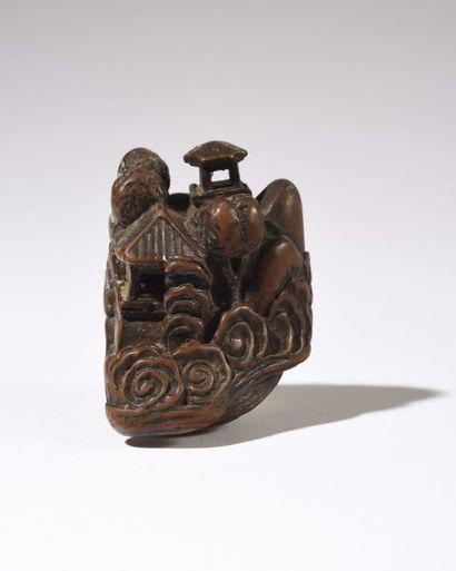 JAPON : Netsuké en bois sculpté représentant...
