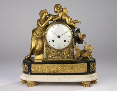 Pendule en bronze doré, marbre noir et marbre...
