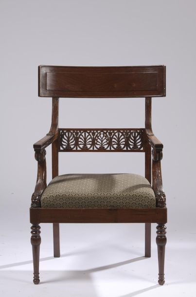 A suite of six armchairs with moulded and carved mahogany veneer and entablature...
