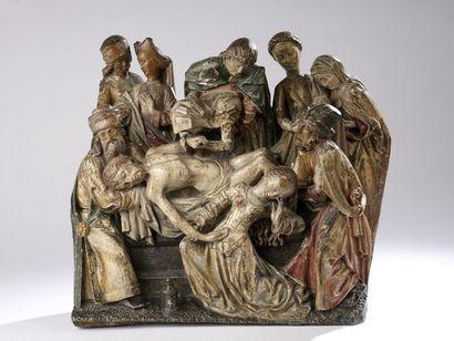 Mise au tombeau en chêne sculpté et polychromé, élément de retable. Le corps du...