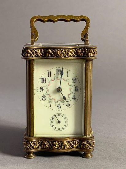 Pendulette de voyage en bronze à deux cadrans...