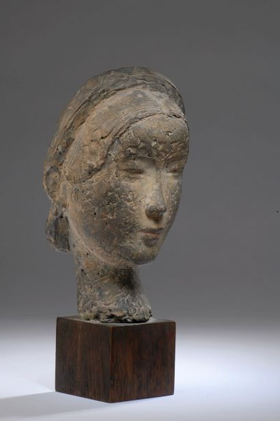 VU CAO DAM (1908-2000). Head of a young woman. Patinated terracotta signed in ink...