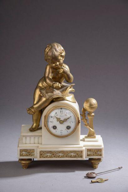 Pendule en bronze ciselé et doré et marbre...