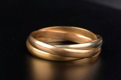 Bracelet composé de trois joncs entrelacés...