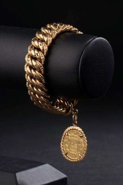 Bracelet en or jaune 18k à maille américaine...