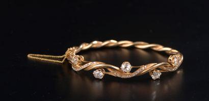 Bracelet jonc en or jaune 18k à deux brins...