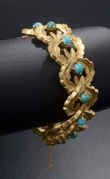 Bracelet en or jaune 18k formé de maillons...