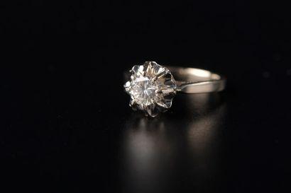 Bague en or gris 18k griffée d'un diamant...