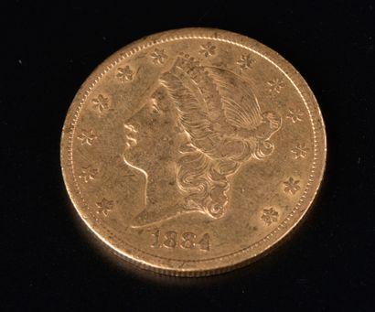 Une pièces en or de 20 Dollars américain,...