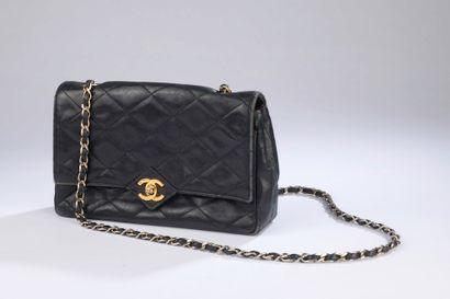 CHANEL.  Black quilted lambskin bag, the...