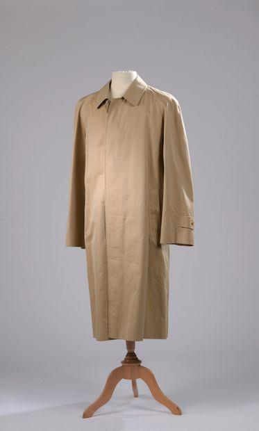 BURBERRY.  Trench coat in beige cotton gabardine,...