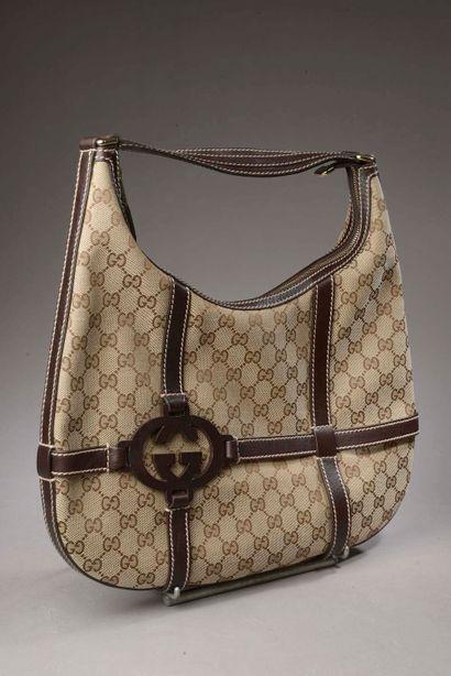 GUCCI.  Shoulder bag in monogrammed canvas...