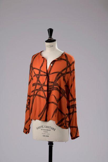 HERMÈS.  Collarless blouse in silk muslin...