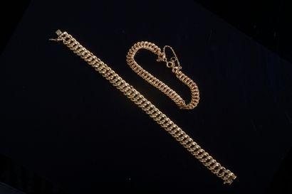 Bracelet gourmette en or jaune 18k.  Long....
